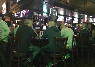 Guests enjoying a UFC fight at our bar
