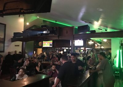Our bar full of guests watching a UFC fight