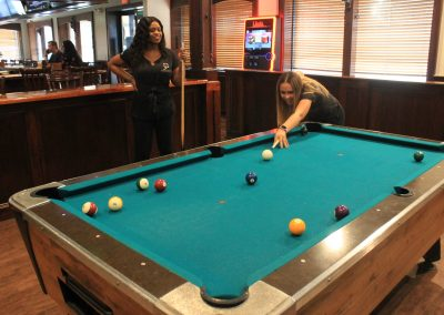 Two of our bartenders playing pool