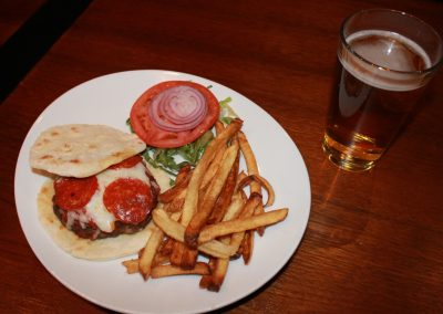 Pizza Burger with French Fries and a Beer