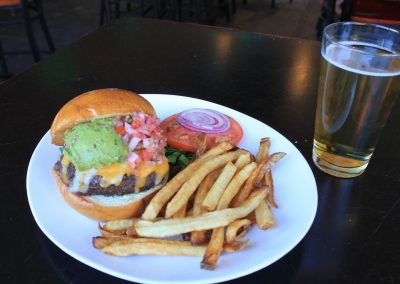 Southwest Burger with French Fries and a Beer